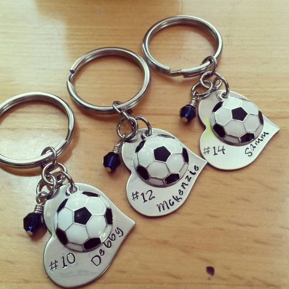 Check out this item in my Etsy shop https://www.etsy.com/listing/252920193/hand-stamped-soccer-keychain-girls