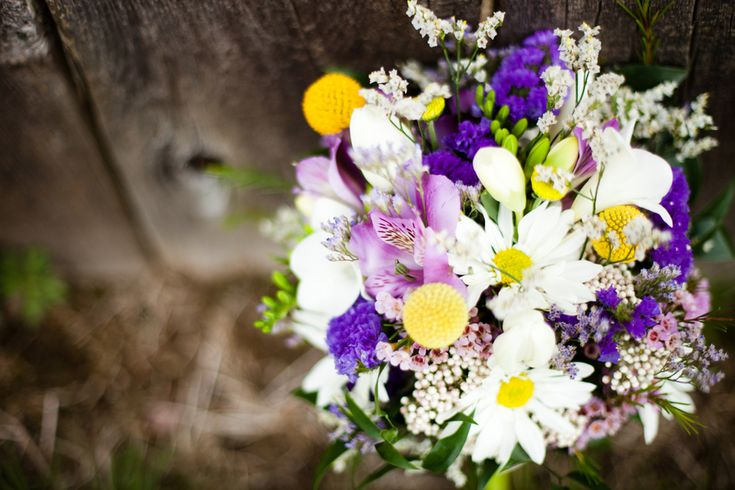 Purple yellow and white bouquet for spring wedding