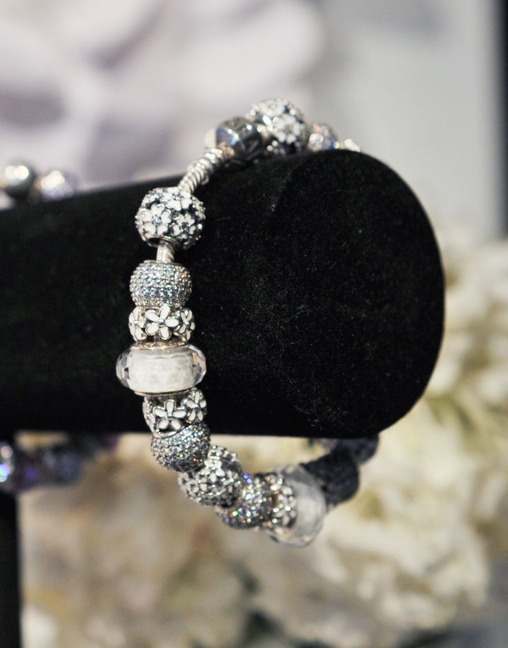 Combine white and silver charms for a trendy all white look. #PANDORA #PANDORAbracelet