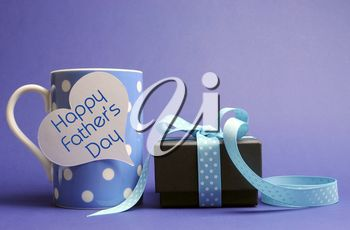 Happy Father's Day blue polka dot coffee mug for breakfast with black box present gift with polka dot ribbon and white heart shape tag with Happy Fathers Day message