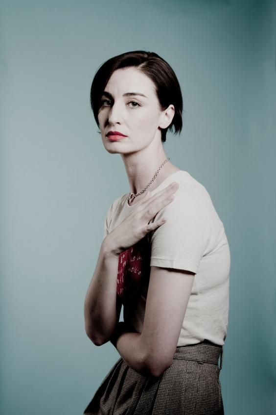 Erin O'Connor's beauty is so startling, so offensively gobsmacking that I do the only adult, sensible thing when faced with it: run away.
