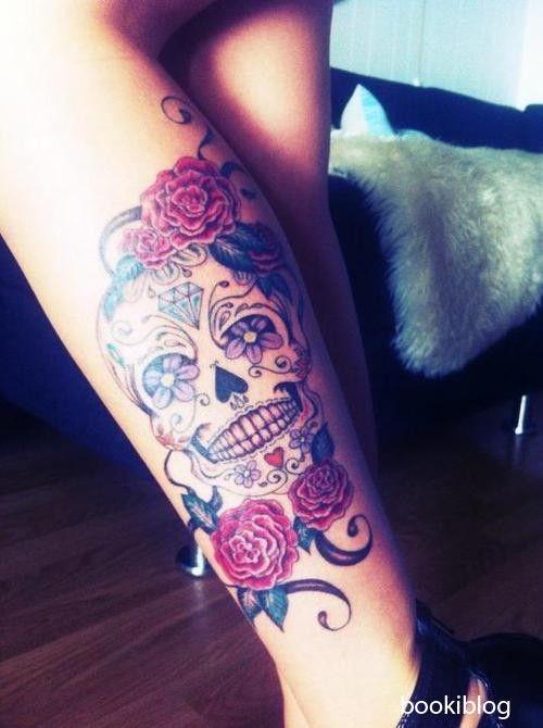 Feminine Skull Tattoo On Leg photo - 1