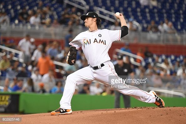 News Photo : Jeff Locke of the Miami Marlins throws a pitch...