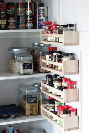 Hang Ikea spice racks on the inside of cabinet door to free up shelf space.