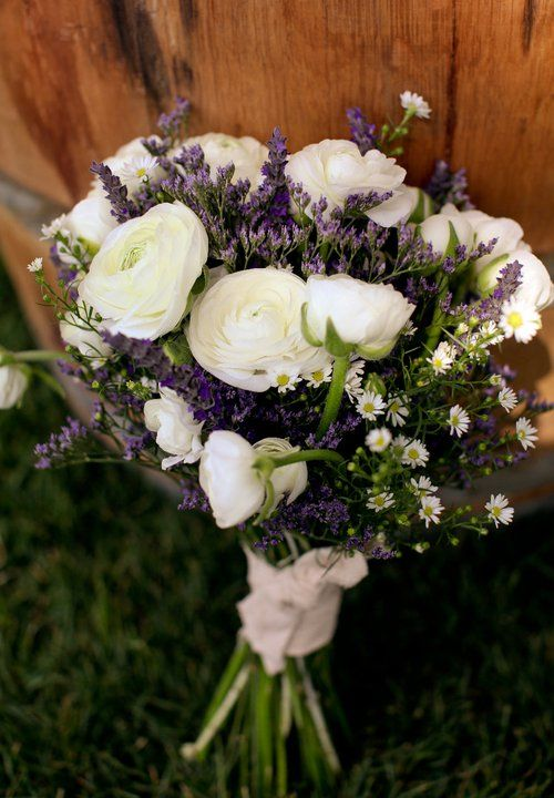 Wedding Bouquet. White Ranunculus, mini daisies, lavender & rosemary.