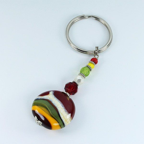 A handmade Murano glass bead African Landscape keyring is a nice affordable addition to your shopping basket. Choose the one that best matches your bracelet, necklace or earings.
