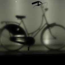 Old Dutch bicycle behind glass screen.