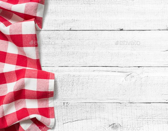 checked picnic tablecloth on white wood table background