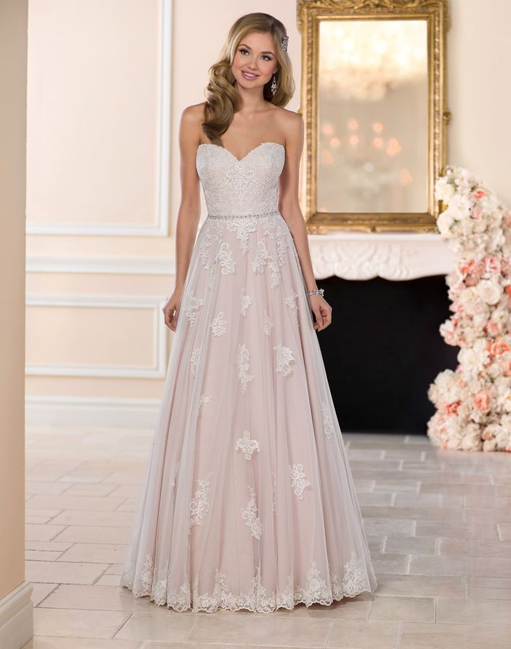 6466 // With its figure-flattering, A-line silhouette, this lace and tulle over matte-side lustre satin gown highlights your waist with its detachable, beaded belt and frames your face with its romantic, sweetheart neckline.