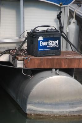http://www.pontoonboatpartsandaccessories.com/pontoonboatbatteries.php has some info on boat batteries and how to install them.