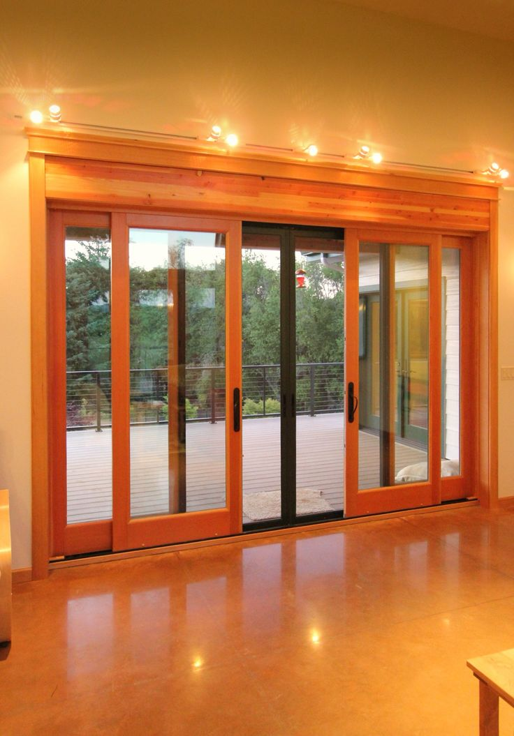 Marvin clad ultimate sliding doors accent the polished for Marvin sliding screen door