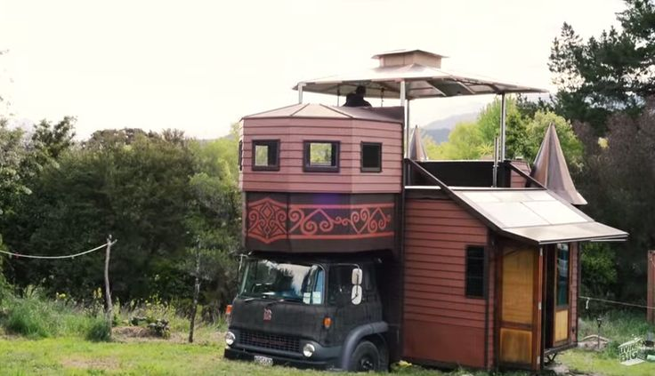 3-story 40 square metre 'Castle' housetruck with its own turrets containing a shower & composting toilet! This engineering masterpiece includes a full working kitchen, washing machine, a large food dehydrator,  a loft, a rooftop bathtub, pull-out solar panels, gas & a wetback fireplace.