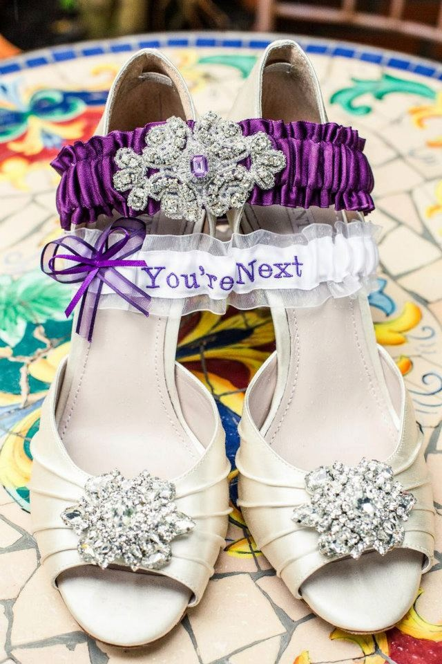 """""""You're next"""" garter toss in your wedding color."""