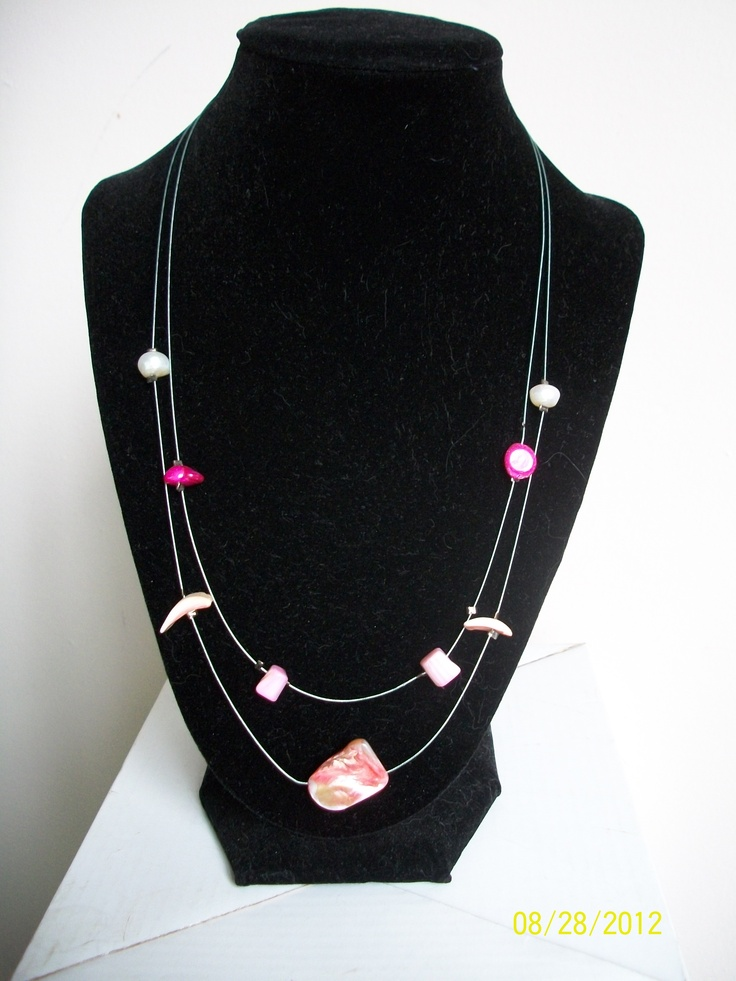 Double strand wire necklace with suspended pink shells and beads - $18