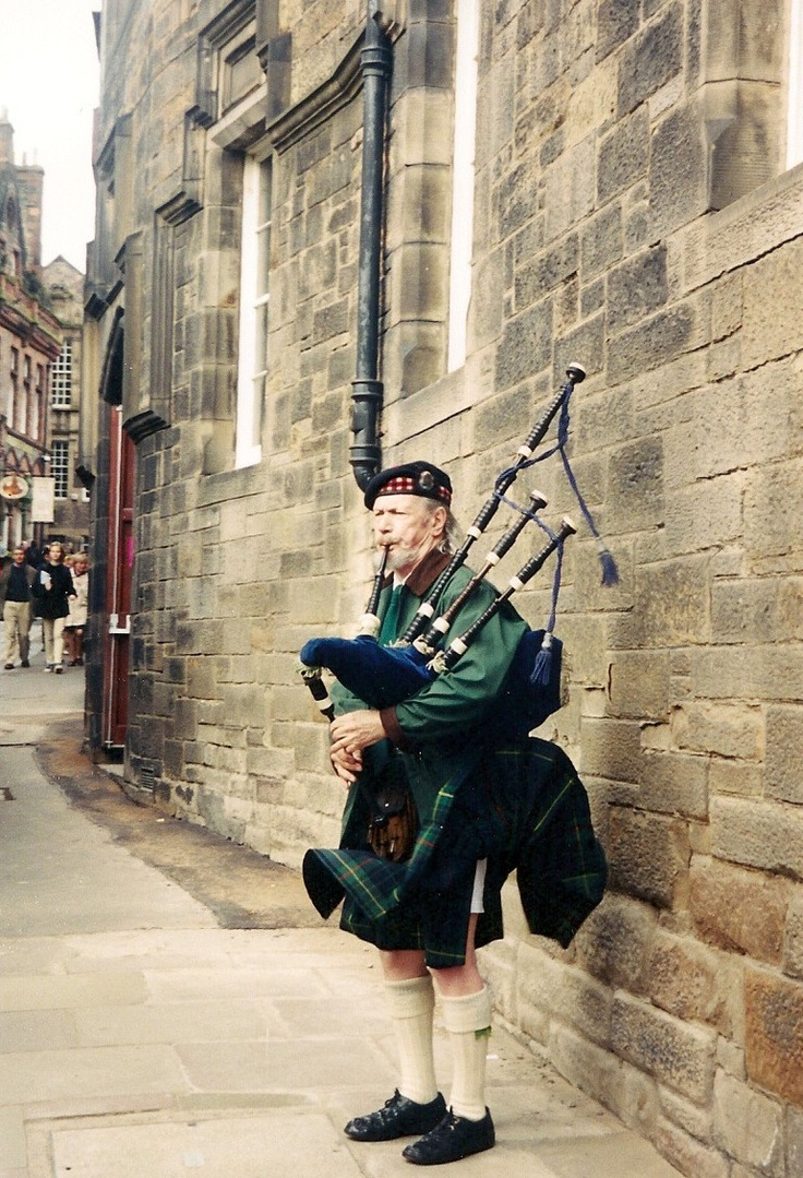 The Royal Mile in Edinburgh, Scotland. Bagpipers play up & down the Mile daily
