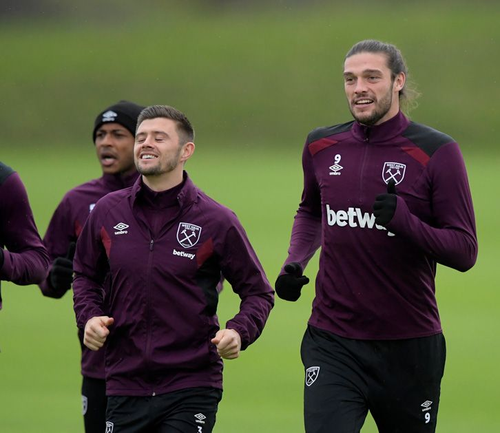 Aaron Cresswell and Andy Carroll loosen up with a run