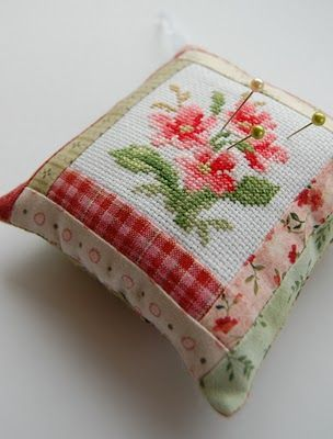 LOVE this pin cushion with the floral cross stitching and log cabin quilting! (No link for the cross stitch design. The 'how to' finishing tutorial is at this blog - it's Norwegian but the pics are easy to follow!)