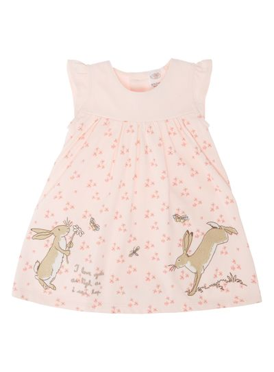 This adorable smock dress with an attached bodysuit is detailed with the cute Guess How Much I Love You character rabbit embroidered detail. With frill sleeves and crew neckline, this floral dress made from pure cotton is fastened with buttons at the back.<ul><li>Girls pink Guess How Much I Love You dress</li><li>Frill sleeves</li><li>Crew neckline</li><li>Attached bodysuit</li><li>Floral print</li><li>Keep away from fire</li></ul>
