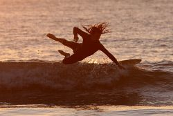 TWA-0051388 © WestPix Sunset surfers at Freo beach. Picture by Sharon Smith The…
