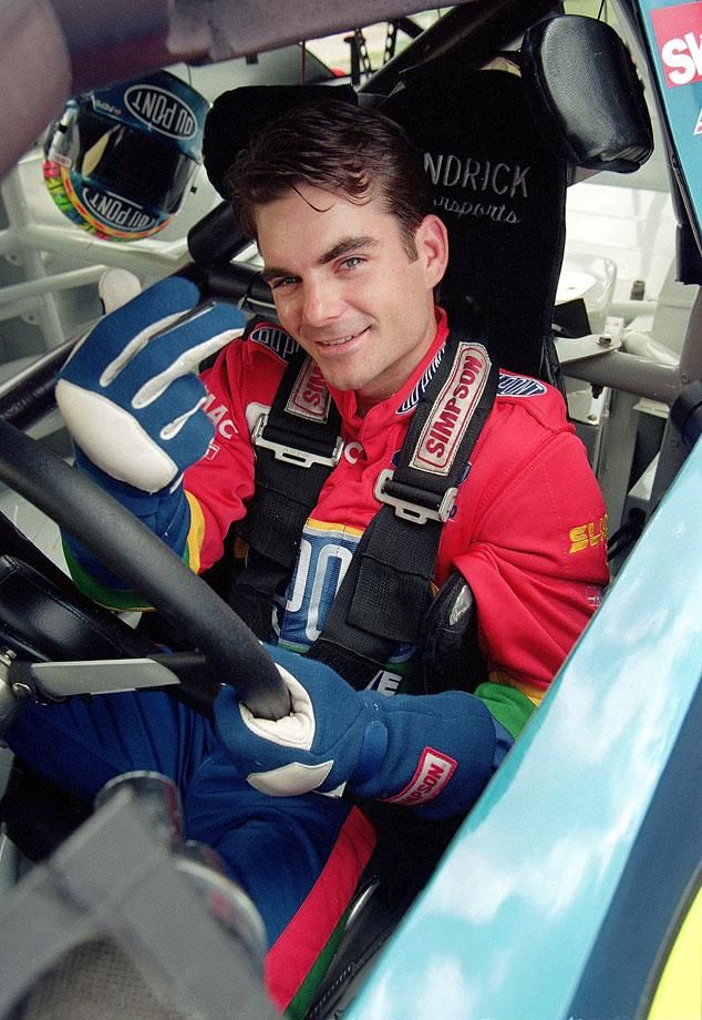Jeff Gordon poses in his car before a race in Charlotte, N.C........Happy 4th Birthday To Nascar's Jeff Gordon, Born August 4, 1971.  Repinned by Tiffany Says Hop Into My DeLorean   (1).