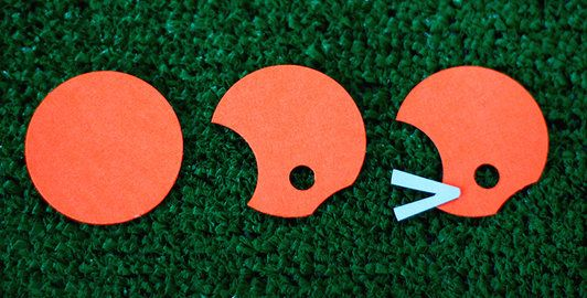 You can make these football helmets using a circle punch and a hole punch.