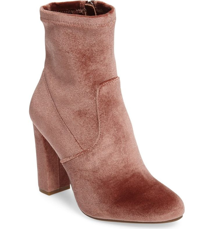 A blush velvet shaft and a streamlined design combine to create minimalist appeal for this block-heel bootie that's sure to be a wardrobe staple.