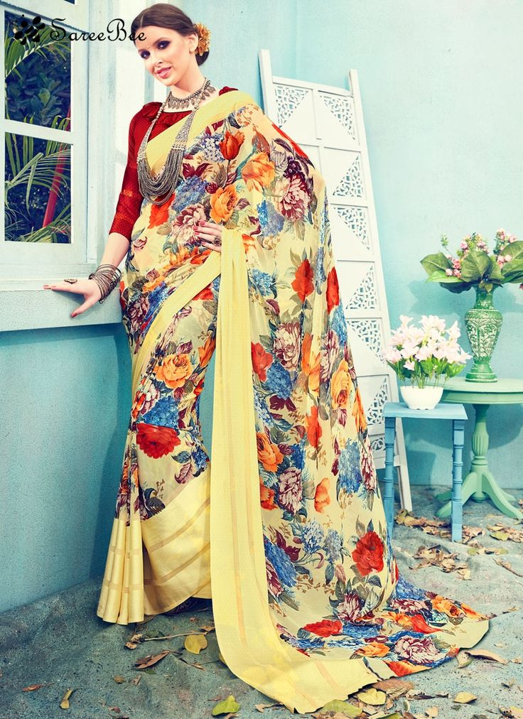 Angelic Print Work Satin Printed Saree  Grab the second look in this elegant attire for this season. Be your own style icon with captivating multi colour satin printed saree. The ethnic print work on the attire adds a sign of beauty statement to your look. Comes with matching blouse.