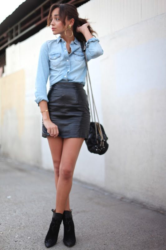 Shop this look on Lookastic:  http://lookastic.com/women/looks/denim-shirt-mini-skirt-ankle-boots-crossbody-bag-earrings/11312  — Gold Earrings  — Light Blue Denim Shirt  — Black Leather Mini Skirt  — Black Leather Crossbody Bag  — Black Suede Ankle Boots