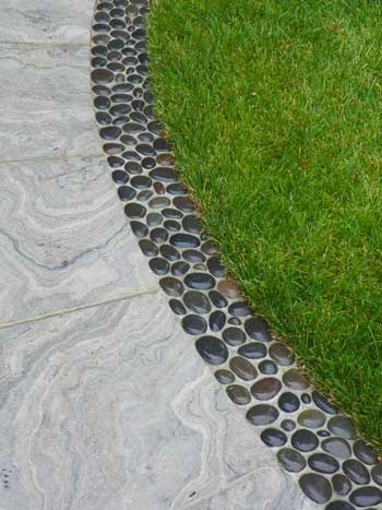 Edging idea, set polished rocks in concrete.