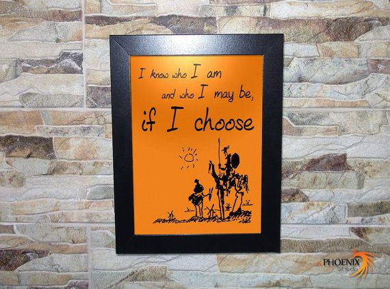 don quixote quote on wooden frame i know who i am and