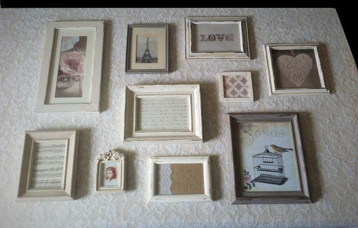 A casual arrangement of shabby chic style rustic picture frames in neutral shades of cream and linen chalk paint. Feminine French style inserts.