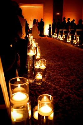 Use floating candles in rented cylinder vases down the aisle for the ceremoy. Unique Event Design