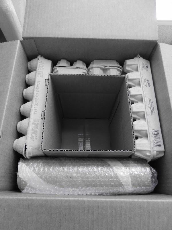 Safely packing and Shipping a Teapot or other breakables. Recycle egg boxes as packing and double box