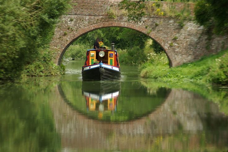 Narrowboat with reflection