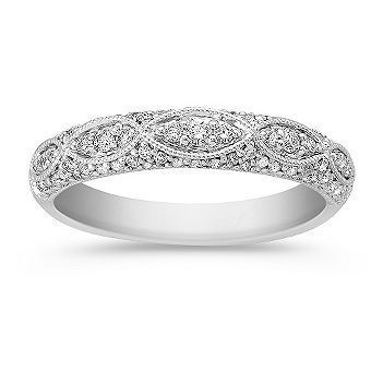 Seventy-three round diamonds, at approximately .35 carat total weight, sparkle and shine in this vintage inspired band. The band is crafted from quality 14 karat white gold. This stunning design is part of our Legacy collection and will look great with any ring or wear it alone for a classic look.