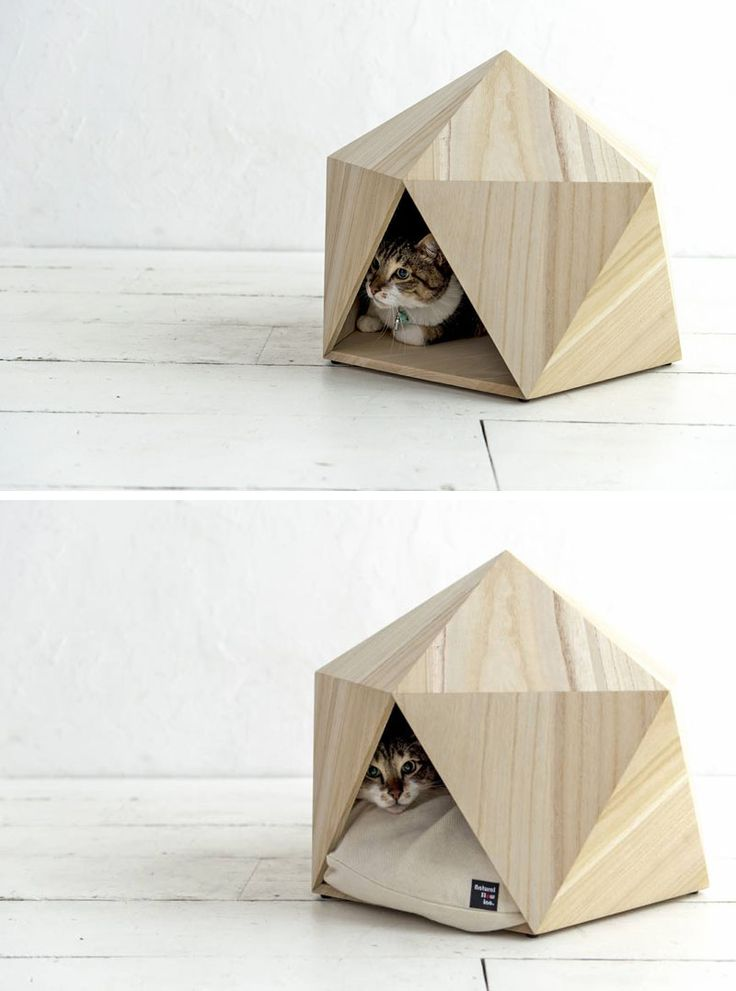 This small unique and modern pet bed made from wood is the perfect cat cave