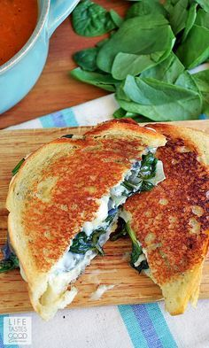 Spinach Artichoke Grilled Cheese | by Life Tastes Good is the classic dip in sandwich form and totally tasty! This Grilled Cheese sandwich is loaded with fresh spinach, artichokes, and lots of ooey gooey, melty cheese! It's a classic flavor combo, and I'm excited to share it with you in this tasty sandwich recipe! #LTGrecipes #NationalSandwichMonth