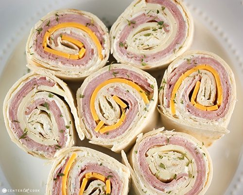 ham and cheese pinwheels: tortilla, ham, cheddar cheese, cream cheese, mayo, dill, onion and garlic powder.