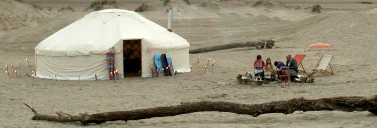 Family staying in a yurt on Shell Island beach