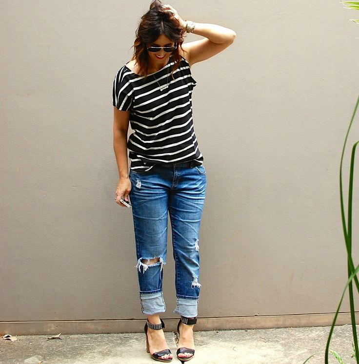 Tee shirt and jeans. Everyone needs a black and white striped tee in their wardrobe. Team it with distressed jeans and then dress it up with heels.