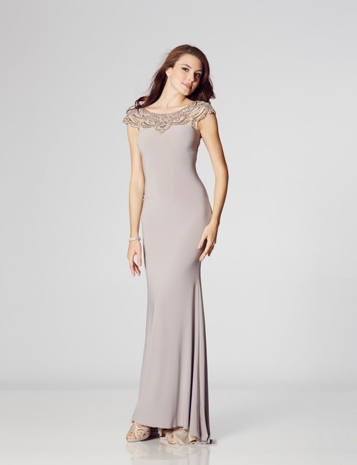 With the beautiful beading draped across your shoulders and chest, the front of this gown is mesmerizing and provides the right amount of bling for those wanting to make a stunning statement.