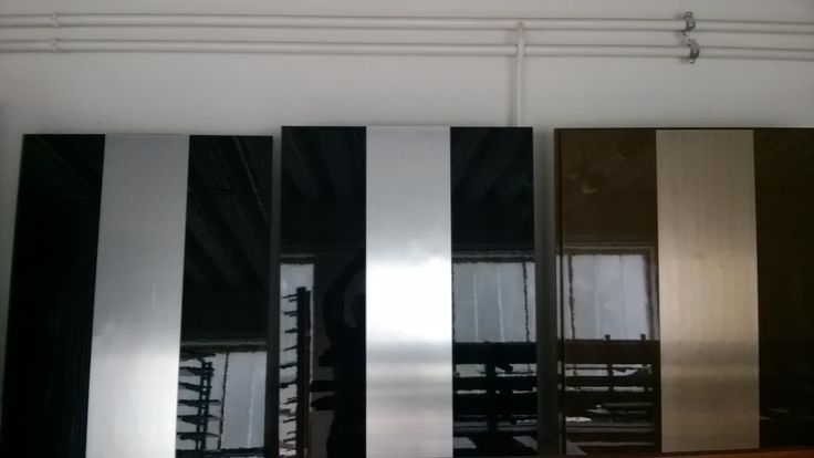 High gloss lacquered doors with Titanium and Brushed copper inlay