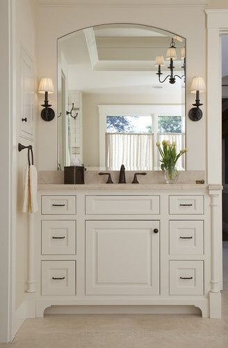 .Basement Bathroom: Oil rubbed bronze fixtures, and sconces next to mirror