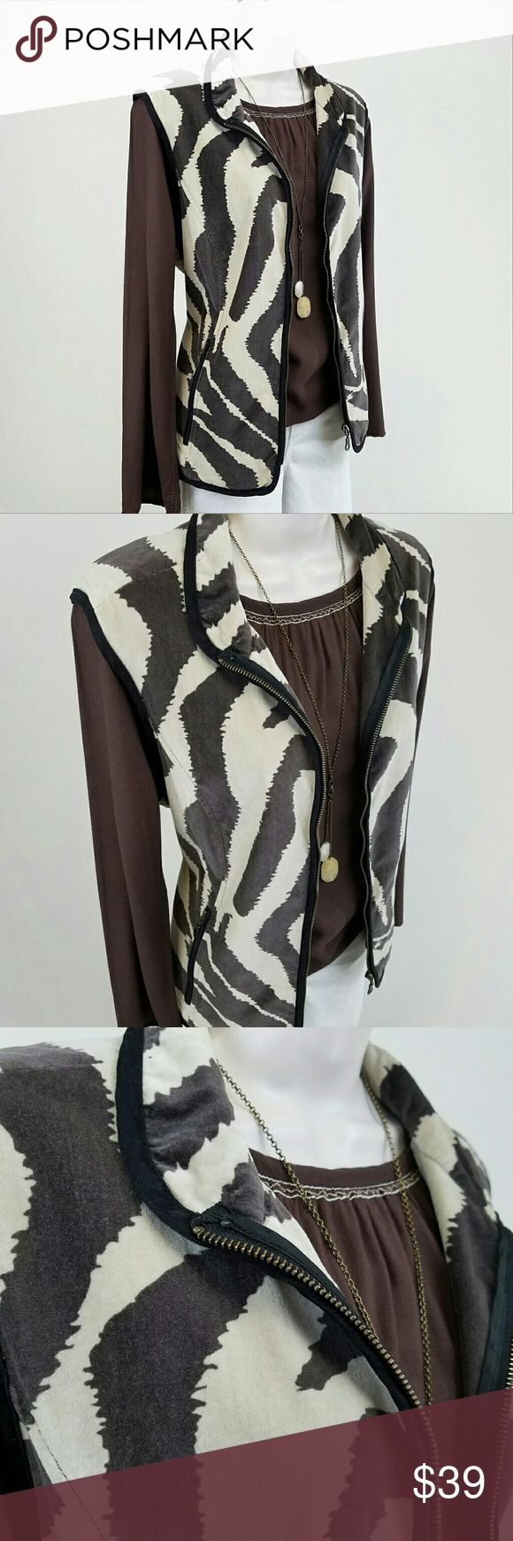 Tasha Polizzi animal print vest: brown, white Sleeveless zip front velvet vest in a brown & off white animal print pattern.  Lined, with on-seam zip pockets & snap tabs on side.  Western chic! Looks great with boots & jeans.  Bust 21 / length 24.5 inches.  100% cotton. Tasha Polizzi Collection Jackets & Coats Vests