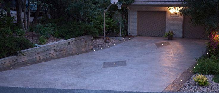LED landscape lights: DEKOR Dek Dots illuminate a stamped concrete driveway at night