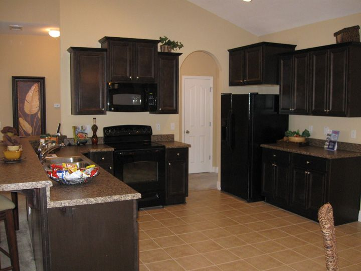 This Glenhurst Kitchen Is Decorated With Dark Wood Cabinets And Appliances  Http://www