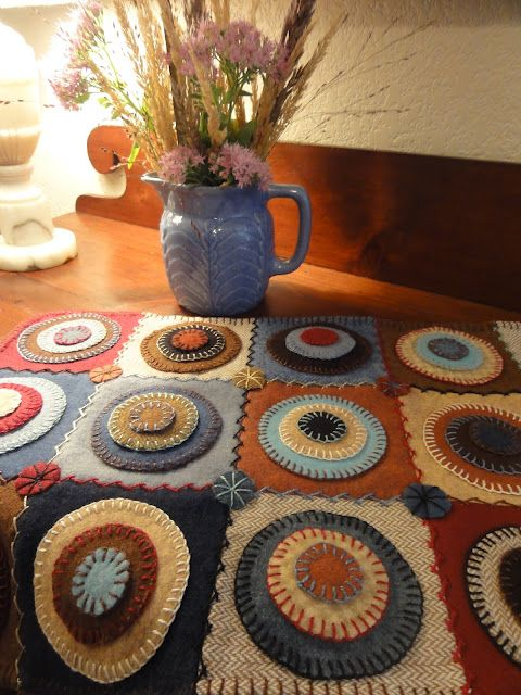 Salmagundi: PENNY RUGS - She put the pennies onto squares - nice