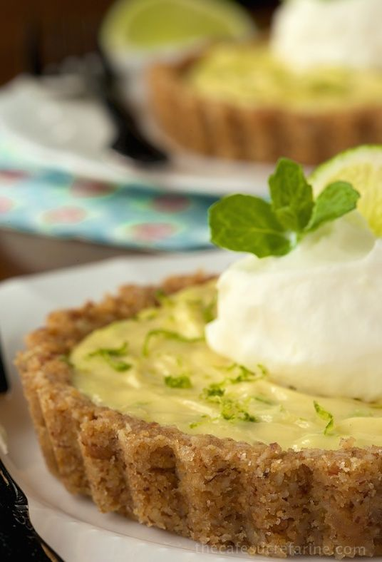 Key Lime Tarts with Coconut Pecan Crust - if you're a key-lime lover, you'll go CRAZY over this. It's a classy step up from every day key lime pie!