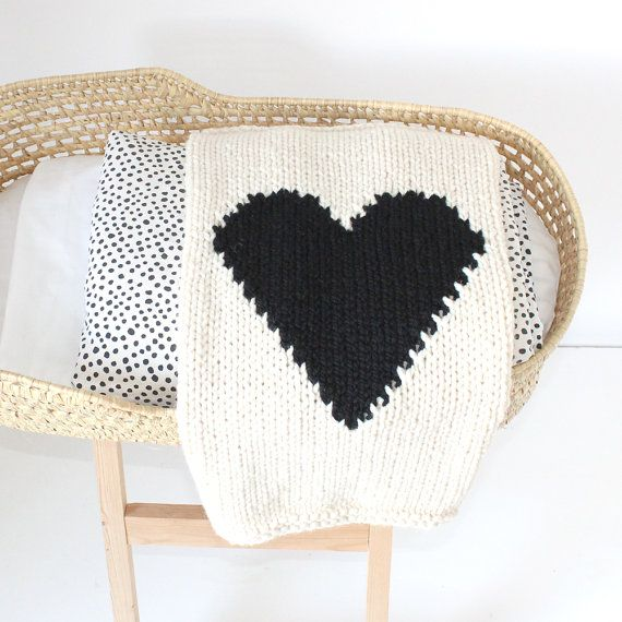 What is sweeter than a hand knit heart blanket? Cream with a black heart to make a bold statement. It is the perfect size for bundling up baby in a