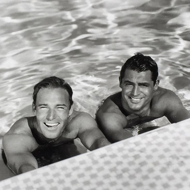 In closeted 1930s era #hollywood studio heads like Louis B. Mayer were famously homophobic but their p.r. departments needed to churn out endless fodder for magazines like #photoplay. Hence this famous image from a spread about the cozy domestic arrangement enjoyed by #carygrant and #randolphscott which features the partners frolicking about their L.A. property.